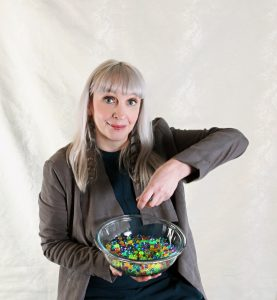 Diane Knoll, OTR/L playing with a bowl of water beads as an example of tactile play. Tactile play and exploration is an important component of a sensory diet.