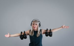 A picture of Diane Knoll, OTR/L wearing headphones for the therapeutic listening program. Therapeutic Listening can help decrease auditory defensiveness and improve  the ability to discriminate sounds.